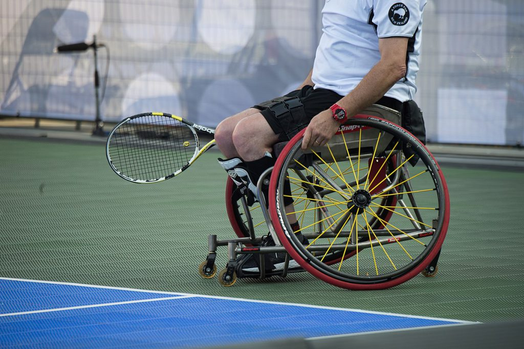 man playing wheelchair tennis
