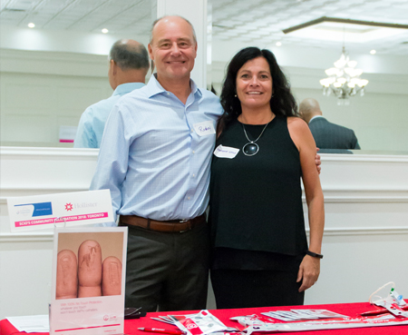 Representatives from a sponsor for SCIO at an event